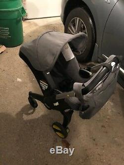 Doona Classic Infant Car Seat/Stroller Gray (Storm) 2018 INCLUDES BASE And Bag