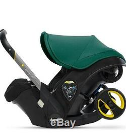 Doona Infant Baby Car Seat Travel Stroller racing green With Latch Base